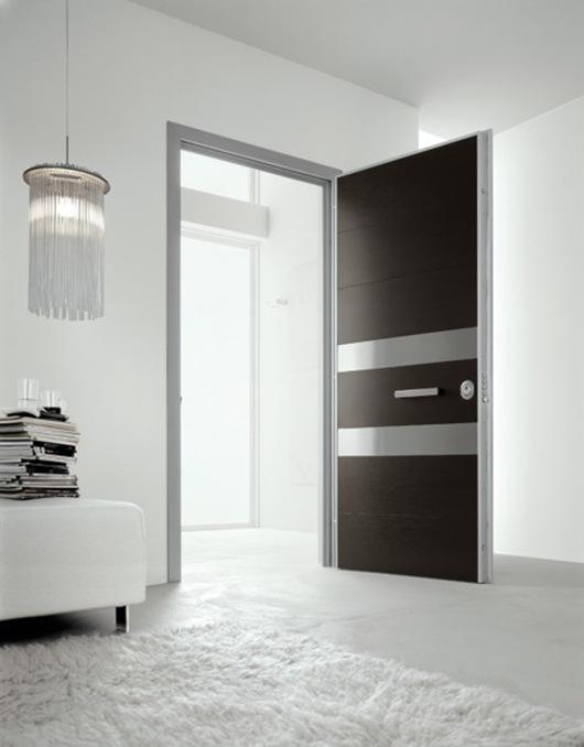 Puertas modernas para hogares contempor neos de oikos for Colores para puertas exteriores