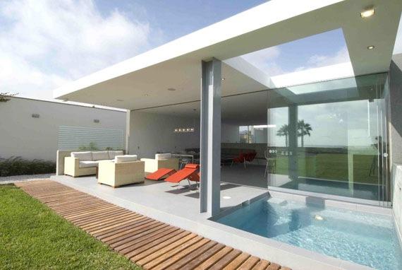 Casa de playa la isla por juan carlos doblado interiores for Decoracion de casas de playa modernas