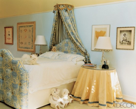 cozy-girl-bedroom-with-an-upholstered-bed-and-crown-canopy-554x443