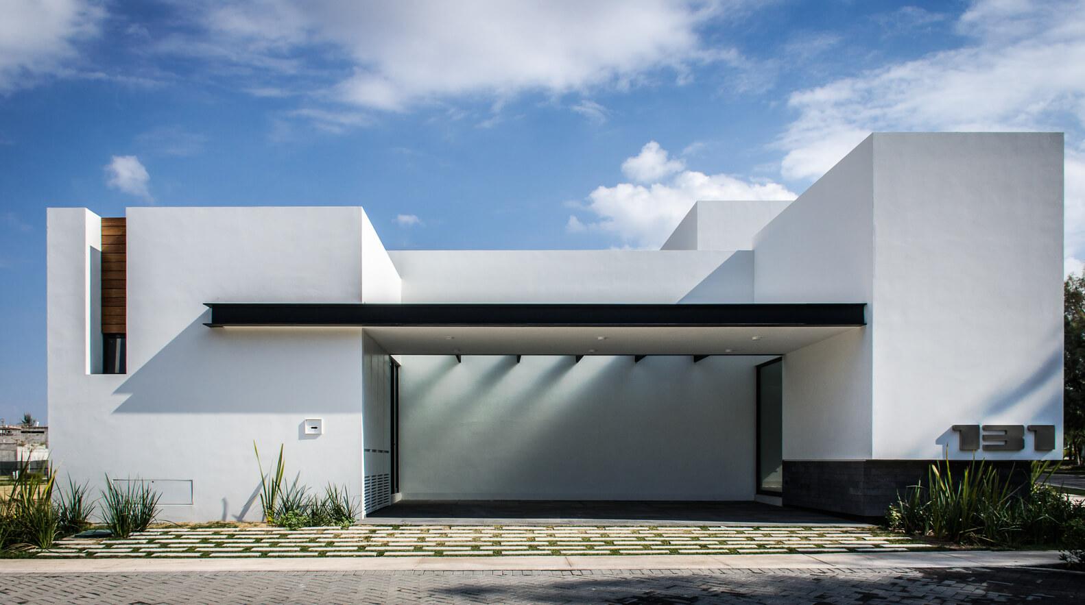 16 fachadas modernas diganas de imitar interiores for Fachadas de casas minimalistas 2016